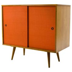 Paul McCobb Small Grasscloth Cabinet 1950's | From a unique collection of antique and modern cabinets at https://www.1stdibs.com/furniture/storage-case-pieces/cabinets/