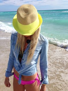 neon yellow banded hat + chambray button up tied at the waist + hot pink bikini bottoms