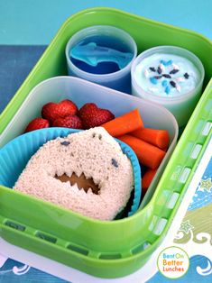 This peanut butter sandwich shark looks ready to jump out of the lunchbox! Strawberries, carrots, tinted greek yoghurt and a gummy shark fill the rest of this shark-inspired lunchbox.