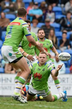 Blake Austin of the Canberra Raiders offloads during the round 16 NRL match between the Gold Coast Titans and the Canberra Raiders at Cbus Super Stadium on June 26, 2016 in Gold Coast, Australia.