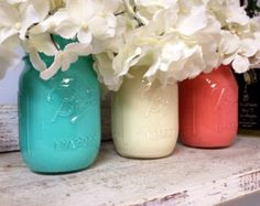 Painted Aqua, White, and Coral Mason Jars. Perfect for Gifts, Home Decorations, and Weddings.