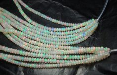 Beautiful genuine full fire white  Ethiopian Opal facet rondelle, size 2.5-4 mm sold by set of 20 beads