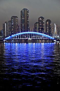 Blue Arch by chibitomu on Flickr.  This is the Eitai-bashi bridge over the Sumida River. Behind is the River City 21, Tokyo, Japan.