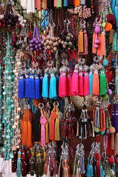 Pompons and tassels in a wonderful display of colour found in Marrakech souk. Ailleurs communication, www.ailleurscommunication.fr Jeux-concours, voyages, trade marketing, publicité, buzz, dotations                                                                                                                                                     Plus