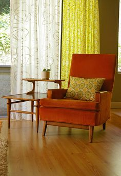 """I like this look, and of course, I can always go green b/c I know it'll look good with our orange chairs. However, I think this color scheme might be saying """"sit and visit with me,"""" and I'm wanting it to say, """"come, sit, read."""""""