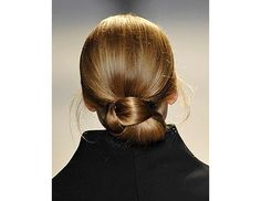 @Byrdie Beauty - Smooth and sleek, this polished bun is perfect for a formal affair.