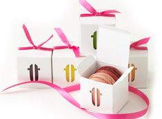 """Here is a fabulous favor idea for anything form weddings to dinner parties. The sweet treat is super cool and will look great at any place setting. The Paulette mini-box makes a memorable impression as a unique gift to send home with your dinner or party guests. Featuring the signature logo as a cutout, the mini-box lets you peek at the vibrant flavors you've selected from our """"champ de macarons."""" mini-box of 2 macarons $4…"""