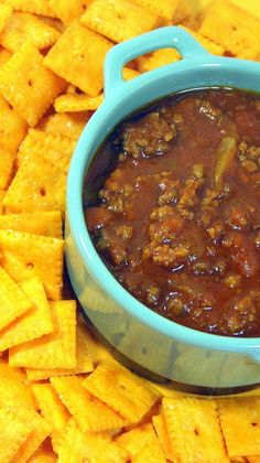 Chili with Beans - On a bitter cold day, you want CHILI... It's hot now but winter will come again...  This is a simple classic recipe, meat, beans, seasonings all served up in a thick soupy gravy.  Delicious and MY FAVORITE!