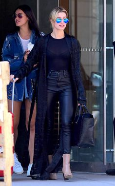 Hailey Baldwin steps out in NYC donning contemporary aviator shades complete with blue flash lenses.