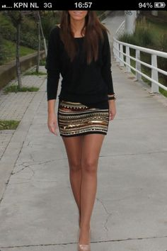 Tan and black skirt, solid black top