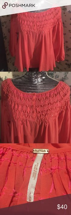 Free People salmon cotton blouse Cute as anything salmon cotton blouse with pink cross stitch mesh by Free People. Very freeing but still demure. Great condition with slight imperfections, not noticeable to anyone unless you are looking for them. Fantastic piece to your wardrobe. Free People Tops Blouses