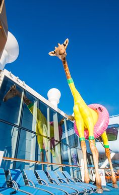 Go gaga for Gigi. Anthem of the Seas' resident 32-foot-tall giraffe grazes deck 15 near the rock climbing wall.