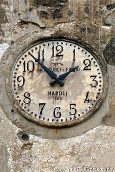A Napoli 1920 clock face in old stone