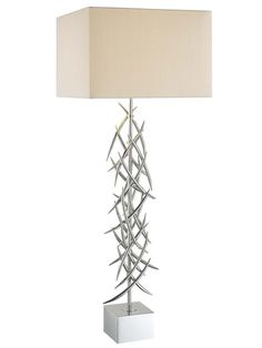 Thorn Bush    Make a bold, unique design statement with an out-there table lamp, like this one with a metal thorn base from Ambience.