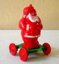 Vintage Rosbro Plastic Santa Claus on Wheels