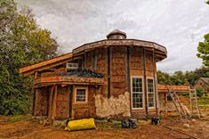 unfinished cob and straw bale house