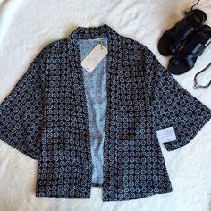 Kimono Cardigan Printed black kimono style wrap cardigan. You can tie it around the waist. Silky lightweight material. INK+IVY Tops Blouses