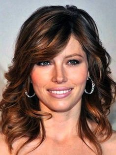 What great dark color....Love the cut and style. This is a great in-between lengths look.