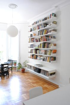 0f7d24df315 The shelving unit is comprised of 9 identical pieces cantilevered off a  plaster and masonry white