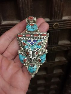 A personal favorite from my Etsy shop https://www.etsy.com/listing/486993281/tribal-raw-stone-large-pendant-tibetan