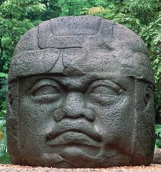 """[Colossal head, Olmec, La Venta, Mexico, 900–400 BCE. Basalt, 9'4"""" high. Museo-Parque La Venta, Villahermosa.] The colossal head in the Olmec civilization was basically a symbol of the royalty and God. Where Olmecs lived, there was no basalt. Thus, this indicates trade and travel - the only way to transport such monuments was to roll it down the waterways/rivers."""