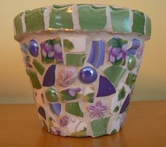 Beautiful. Love the use of solids to accent the florals. Sweet Violets Pique Assiette Mosaic Flower Pot