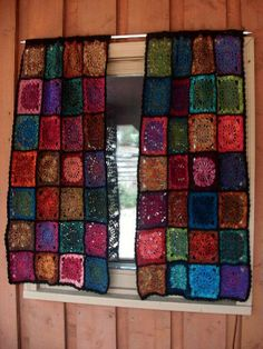 granny square curtains ~ have a bunch of people make granny squares, then make curtains for nook with them
