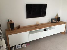 I hacked a BESTÅ TV Unit with Oak wrap around. The process was quite straightforward, cutting the wood to length correctly to make long TV unit Ikea Tv Unit, Wood Tv Unit, New Living Room, Home And Living, Living Room Decor, White Tv Unit, Ikea Tv Stand, Tv Cupboard, Tv Unit Decor
