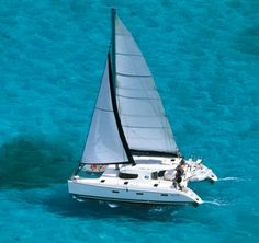 Catamaran  One day I will be on a boat like this sailing on water just this shade of turquoise.