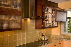 Lift-up cabinet doors with lumicor acrylic inserts in autumn zito light - Bellmont Cabinet Co.