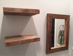 Floating reclaimed wood shelves and reclaimed wood mirror. Perfect update for a guest bathroom! Shelves and wood mirror from Oak + Elegance. @oakandelegance