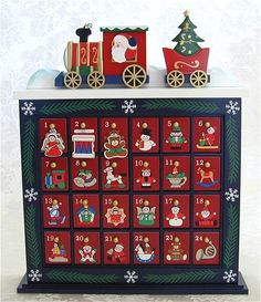 I want the hubby to make a box like this with little doors so I can put little nativity pieces in each one.