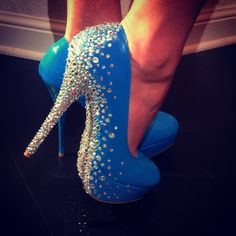 Rhinestones on a pair of blue stilettos