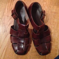 Dark colored. Sandals. Like brand new. Worn once Made in Brazil. Man made materials.almost brand new! Great show Shoes Sandals