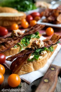 BLT Crostini with Boursin Cheese - A delicious appetizer that looks super fancy but is very easy to make!  Rich roasted tomatoes, bacon and Boursin cheese on a toasted crostini.  YUM!