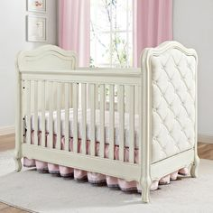 Design a nursery like no other starting with the Bertini Tinsley 3-in-1 Upholstered Crib. This lovely solid wood crib features fine wood cuts, tasteful curves and Queen Anne style legs and feet which are all beautifully accentuated with a hand rubbed, antique white finish. The lavishly curved end panels are upholstered in a soft beige fabric with elegant button tufting.
