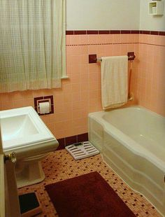 Peachy pink vintage tile bathroom with lovely mosaic tile floor to match. Built in ceramic toilet paper holder and towel bars Maroon Bathroom, Burgundy Bathroom, Pink Bathroom Tiles, Peach Bathroom, Pink Tiles, Black Tiles, Vintage Bathrooms, Simple Bathroom, Bathroom Colors