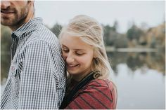 Autumn New Forest engagement shoot couple hugging by lake