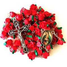 Come closer to the love of Jesus and our Mother as you pray the Rosary every day with this incredible Red Rose Garden Rosary. This magnificently exquisite rosary features gorgeous 10 mm intricately de