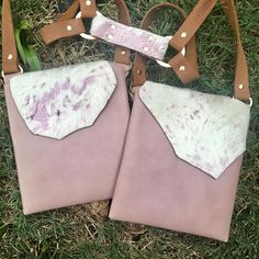 "White & Lilac Holdster~  Made with soft lilac goat skin and designer white and lilac Calf Hair. This is one of a kind, and the color combination creates etherial lightness! Hardware is gold and pocket size will fit up to a iPhone 6s with ¼"" extra room to spare.   #holdster #handsfreepurse #fashionpurse #crossbody #leatherpurse #handmade #minimaliststyle #travelpurse #gypsystyle #bohostyle #lilacpurse #whitepurse #fannypack #securepurse #concertpurse #festivalpurse"