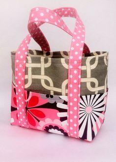 Handmade Tote Bag in Modern Daisy Floral with 6 Exterior Pockets & Polka Dot Coordinating Handles on Etsy, $35.00