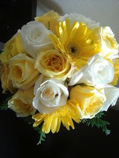 Bright and sunny wedding bouquet with butter yellow and white roses and a few yellow daisies