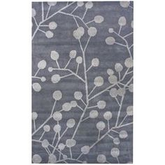 Create a focal point in your foyer or anchor your living room seating group with this hand-tufted wool rug, showcasing a budding vine motif in grey. Product: RugConstruction Material: 100% WoolColor: GreyFeatures: Hand-tuftedNote: Please be aware that actual colors may vary from those shown on your screen. Accent rugs may also not show the entire pattern that the corresponding area rugs have.Cleaning and Care: These rugs can be spot treated with a mild detergent and water. Shake rug from ...
