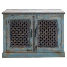 "Crafted from wood and showcasing openwork double doors, this distressed blue cabinet offers antique-chic appeal for your living room or master suite.  Product: CabinetConstruction Material: WoodColor: Distressed blueFeatures: Double doors  Dimensions: 36"" H x 47"" W x 16"" D"