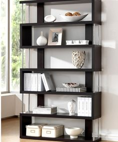 Function and design combine to make this bookcase a fun, new way to decorate the home. Use it to display photographs, souvenirs from globetrotting adventures or favorite books. With playful and contemporary lines, it'll add more storage space in a very stylish way. 43.3'' W x 75.2'' H x 11.4'' DWood / steelWipe clean