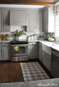 Renovate Small Kitchen gray kitchen features gray shaker cabinets adorned with brass