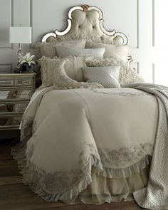"""Callisto Home specializes in taking traditional looks and making them modern as demonstrated by these ruffled and embroidered netting """"Grace"""" duvet covers have an attached skirt. Dust skirts have a cotton lining and 20"""" drop.We added the diamond-textured """"Marquis"""" linens in silver. Pre-washed for softness,  Sheeting by Sferra is made in Italy of 590-thread-count Egyptian-cotton sateen. Detailed with a macrame lace inset threaded with satin ribbon and bordered with hemstitching."""