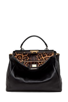 This ones on my 'trophy' list.  Fendi Peekaboo in black leather/leopard