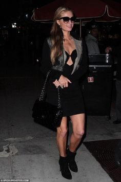 Paris Hilton wearing Dita Paradis Sunglasses in Black, Azzedine Alaia Studded Cutout Suede Boots, Chanel Jumbo Classic Flap Bag Black Patent Leather and Sena Cut Out Dress in Black