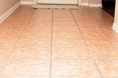 How to Clean Ceramic Tile Floors With Vinegar, sweep and vacuum, half white vinegar half hot water then only hot water